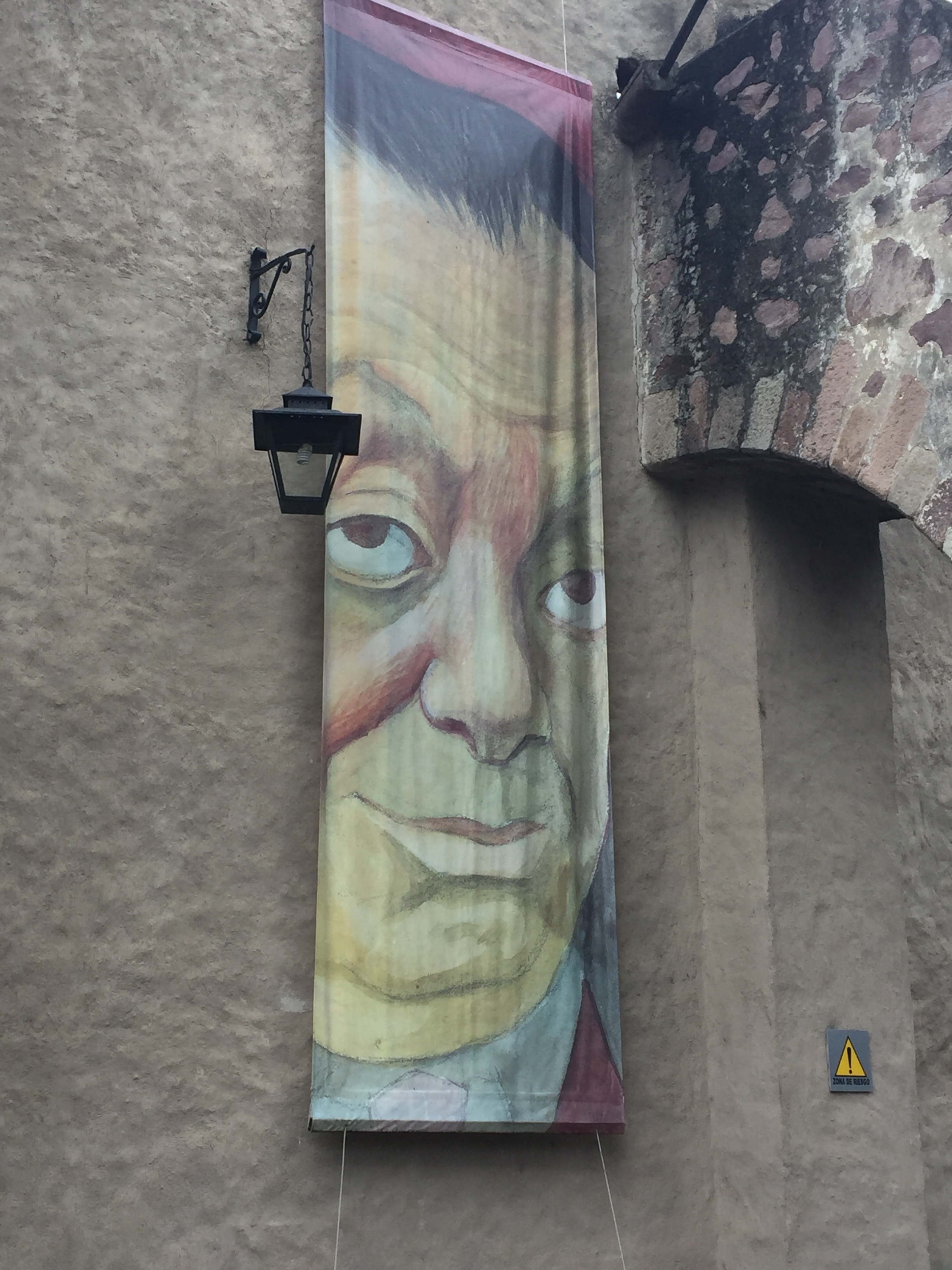 Dolores Olmedo Museum showing a large poster of Diego Rivera self portrait